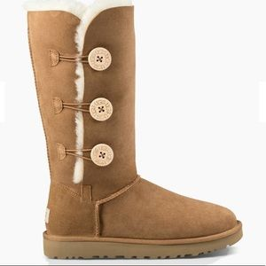 Tall chestnut UGG boots with buttons